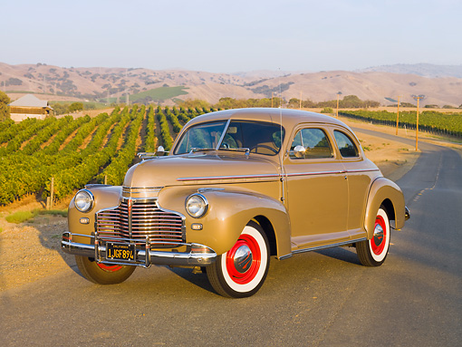 AUT 20 RK0391 01 © Kimball Stock 1941 Chevrolet Master Deluxe Coupe Beige 3/4 Front View On Pavement By Vineyard