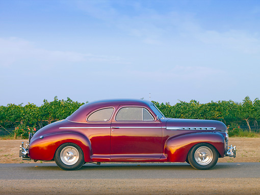 AUT 20 RK0399 01 © Kimball Stock 1941 Chevrolet Special Deluxe Coupe Burgundy Profile View On Pavement By Vineyard