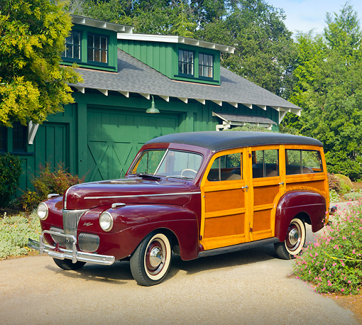 AUT 20 RK0407 01 © Kimball Stock 1941 Ford Woodie Station Wagon Burgundy 3/4 Front View On Pavement By House