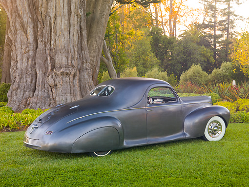 AUT 20 RK0411 01 © Kimball Stock 1940 Lincoln Zephyr Gray 3/4 Rear View On Grass By Trees