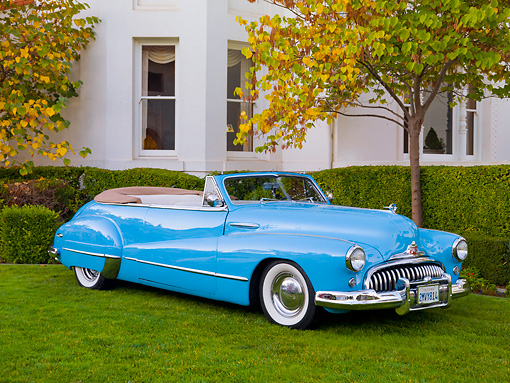 AUT 20 RK0412 01 © Kimball Stock 1946 Buick Super Convertible Blue 3/4 Front View On Grass By House