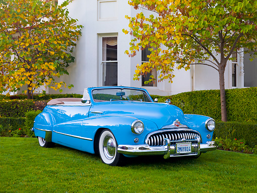 AUT 20 RK0413 01 © Kimball Stock 1946 Buick Super Convertible Blue 3/4 Front View On Grass By House