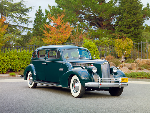 AUT 20 RK0417 01 © Kimball Stock 1940 Packard 160 Touring Sedan 1804 Green 3/4 Front View On Pavement By Trees