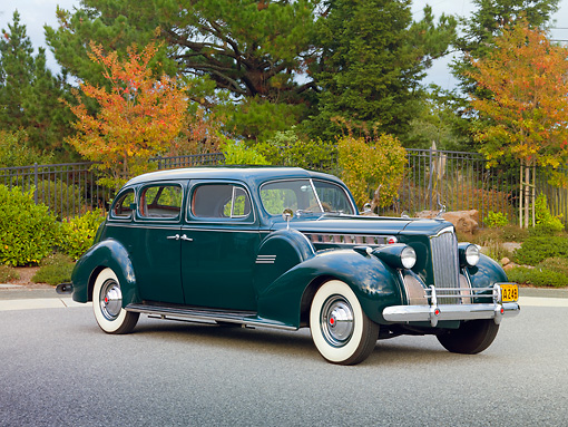 AUT 20 RK0418 01 © Kimball Stock 1940 Packard 160 Touring Sedan 1804 Green 3/4 Front View On Pavement By Trees
