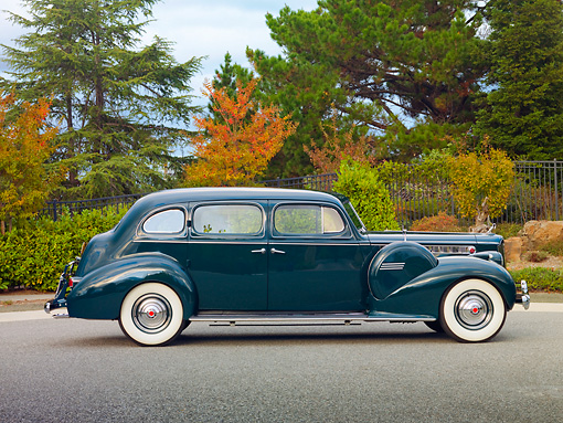 AUT 20 RK0420 01 © Kimball Stock 1940 Packard 160 Touring Sedan 1804 Green Profile View On Pavement By Trees