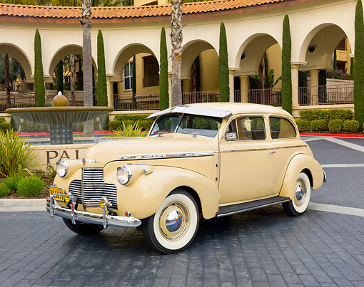 AUT 20 RK0428 01 © Kimball Stock 1940 Chevrolet Special Deluxe Coupe Tan 3/4 Front View On Pavement By Building