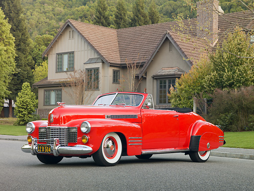 AUT 20 RK0440 01 © Kimball Stock 1941 Cadillac 62 Convertible Red 3/4 Front View On Pavement By House