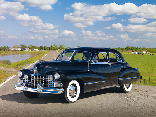 AUT 20 RK0453 01 © Kimball Stock 1942 Cadillac Sedan Black 3/4 Front View On Road By Marsh