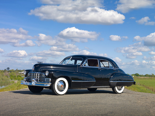 AUT 20 RK0457 01 © Kimball Stock 1942 Cadillac Sedan Black 3/4 Side View On Road By Marsh