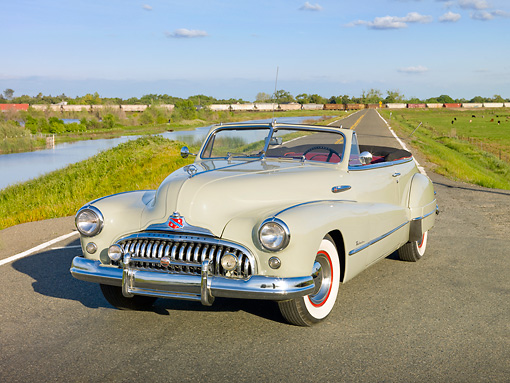 AUT 20 RK0463 01 © Kimball Stock 1948 Buick Roadmaster Convertible Green 3/4 Front View On Road By Marsh