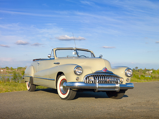 AUT 20 RK0464 01 © Kimball Stock 1948 Buick Roadmaster Convertible Green 3/4 Front View On Road By Marsh