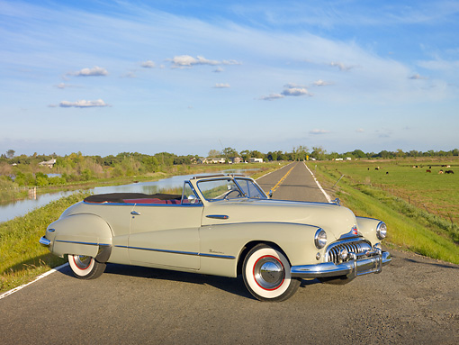 AUT 20 RK0466 01 © Kimball Stock 1948 Buick Roadmaster Convertible Green 3/4 Side View On Road By Marsh