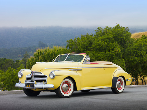 AUT 20 RK0500 01 © Kimball Stock 1941 Buick 56C Convertible Sequoia Cream 3/4 Front View On Pavement By Trees