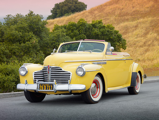 AUT 20 RK0501 01 © Kimball Stock 1941 Buick 56C Convertible Sequoia Cream 3/4 Front View On Pavement By Trees