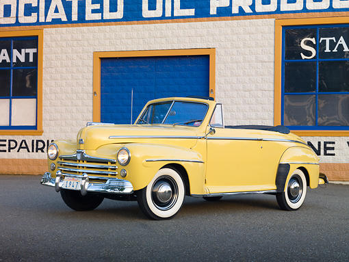 AUT 20 RK0508 01 © Kimball Stock 1947 Ford Super Deluxe Convertible Yellow 3/4 Front View In Front Of Garage