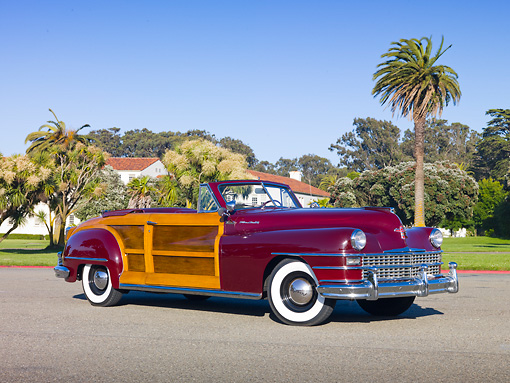 AUT 20 RK0516 01 © Kimball Stock 1946 Chrysler Town & Country Convertible Red 3/4 Front View On Pavement By Trees And Houses