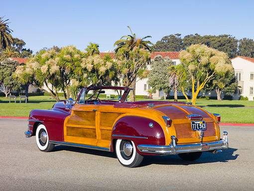 AUT 20 RK0518 01 © Kimball Stock 1946 Chrysler Town & Country Convertible Red 3/4 Rear View On Pavement By Trees And Houses