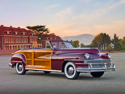 AUT 20 RK0524 01 © Kimball Stock 1946 Chrysler Town & Country Convertible Red 3/4 Front View On Pavement By Building