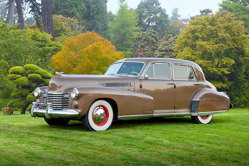 AUT 20 RK0530 01 © Kimball Stock 1941 Cadillac Fleetwood 60 Special Sedan Brown 3/4 Side View On Grass By Trees