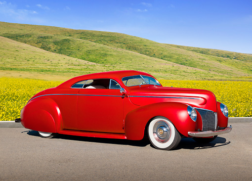AUT 20 RK0541 01 © Kimball Stock 1940 Mercury Coupe Red 3/4 Front View On Pavement By Grassy Hills