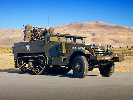 AUT 20 RK0548 01 © Kimball Stock 1944 Anti-Aircraft Military Vehicle 3/4 Front View On Pavement In Desert