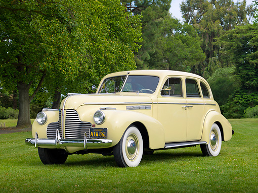 AUT 20 RK0549 01 © Kimball Stock 1940 Buick Special Cream 3/4 Front View On Grass