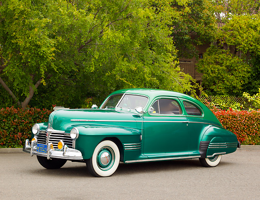 AUT 20 RK0551 01 © Kimball Stock 1941 Pontiac Torpedo Streamliner Two-Tone Green 3/4 Side View On Pavement By Trees