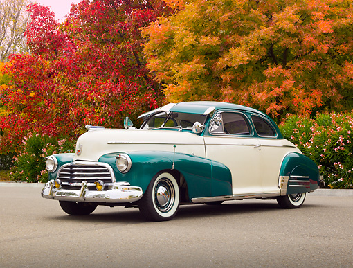 AUT 20 RK0554 01 © Kimball Stock 1946 Chevrolet Fleetmaster White Pearl And Forest Green 3/4 Front View On Pavement By Trees