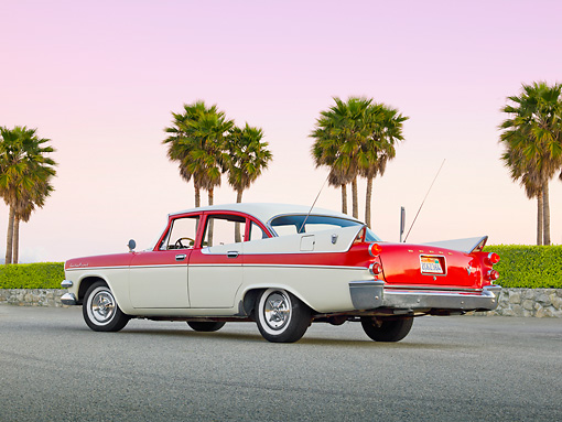 AUT 20 RK0565 01 © Kimball Stock 1957 Dodge Custom Royal Lancer Red And White 3/4 Rear View On Pavement By Palm Trees