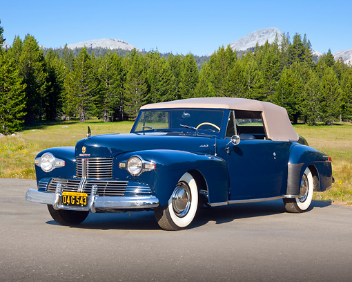 AUT 20 RK0581 01 © Kimball Stock 1942 Lincoln Continental Convertible Blue 3/4 Front View On Pavement