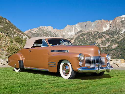 AUT 20 RK0583 01 © Kimball Stock 1941 Cadillac Series 62 Convertible Gold 3/4 Front View On Grass By Mountains
