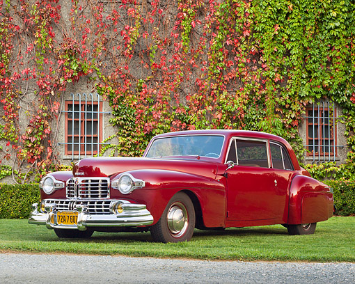 AUT 20 RK0587 01 © Kimball Stock 1948 Lincoln Continental Coupe Maroon 3/4 Front View On Grass By House