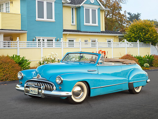 AUT 20 RK0604 01 © Kimball Stock 1946 Buick Super Convertible Blue 3/4 Front View On Pavement By Blue And Yellow Houses