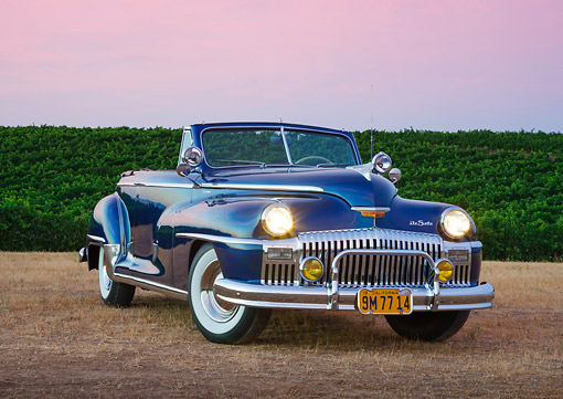 AUT 20 RK0630 01 © Kimball Stock 1948 DeSoto Custom Regal Blue 3/4 Front View On Grass By Vineyard At Dusk