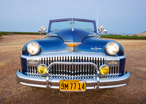 AUT 20 RK0634 01 © Kimball Stock 1948 DeSoto Custom Regal Blue Front View On Grass By Vineyard