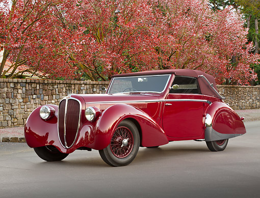 AUT 20 RK0638 01 © Kimball Stock 1947 Delahaye 135M Red 3/4 Front View On Pavement By Cherry Blossom Trees