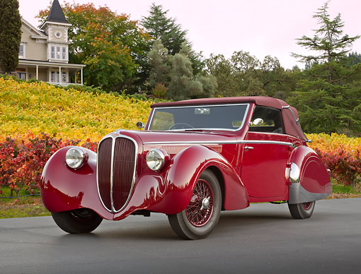 AUT 20 RK0639 01 © Kimball Stock 1947 Delahaye 135M Red 3/4 Front View On Pavement By Autumn Vineyard And House