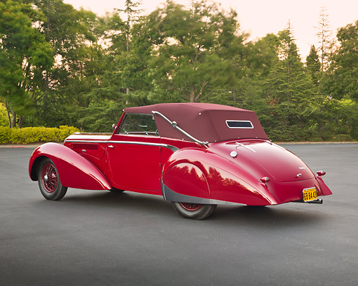 AUT 20 RK0640 01 © Kimball Stock 1947 Delahaye 135M Red 3/4 Rear View On Pavement By Trees