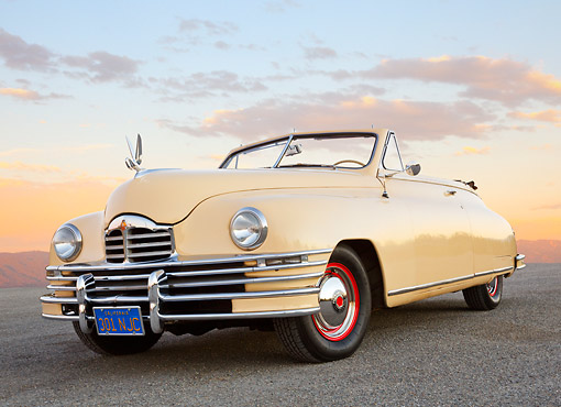AUT 20 RK0652 01 © Kimball Stock 1948 Packard Super 8 Convertible Arizona Beige 3/4 Front View On Pavement At Dusk