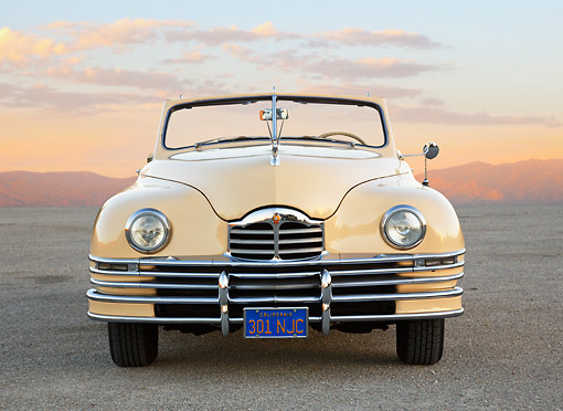 AUT 20 RK0653 01 © Kimball Stock 1948 Packard Super 8 Convertible Arizona Beige Front View On Pavement At Dusk