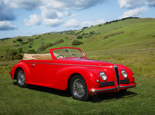 AUT 20 RK0654 01 © Kimball Stock 1942 Alfa Romeo 6C 2500 Red 3/4 Front View On Grass By Hills