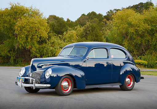 AUT 20 RK0657 01 © Kimball Stock 1940 Mercury Tudor Dark Blue 3/4 Side View On Pavement By Trees