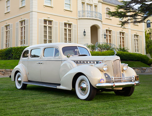 AUT 20 RK0665 01 © Kimball Stock 1940 Packard 1805 7 Passenger Sedan Cream 3/4 Front View On Grass By Mansion