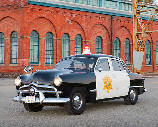 AUT 20 RK0668 01 © Kimball Stock 1949 Ford Police Car 3/4 Front View On Pavement By Brick Building