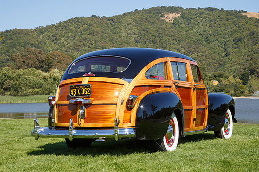AUT 20 RK0674 01 © Kimball Stock 1941 Chrysler Town & Country Black 3/4 Rear View On Grass By Lake