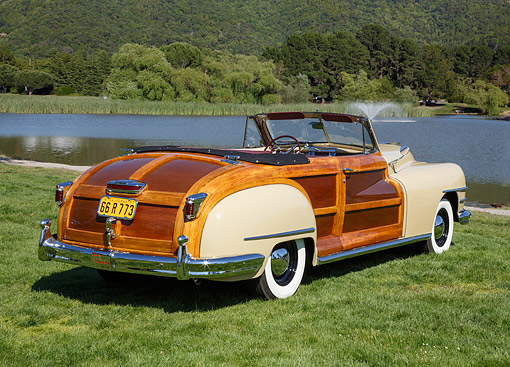 AUT 20 RK0676 01 © Kimball Stock 1947 Chrysler Town & Country Yellow Luster 3/4 Rear View On Grass By Pond