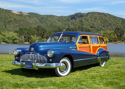 AUT 20 RK0678 01 © Kimball Stock 1946 Buick 592 Blue 3/4 Front View On Grass By Pond