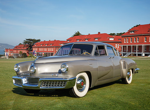 AUT 20 RK0680 01 © Kimball Stock 1948 Tucker Torpedo Gray 3/4 Front View On Grass By Buildings
