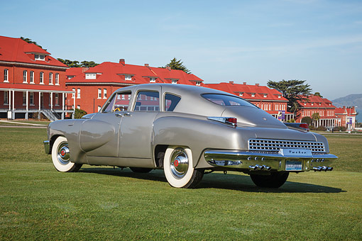 AUT 20 RK0681 01 © Kimball Stock 1948 Tucker Torpedo Gray 3/4 Rear View On Grass By Buildings