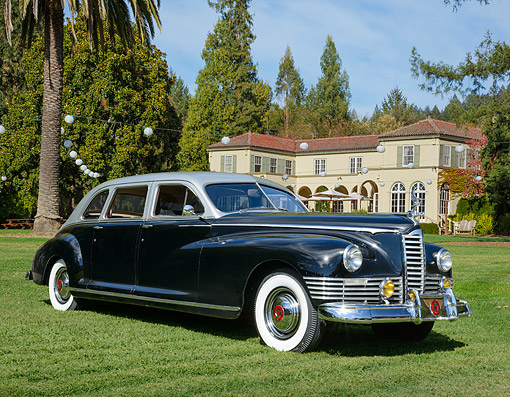 AUT 20 RK0685 01 © Kimball Stock 1946 Packard Custom Limo Black And Silver 3/4 Front View On Grass By House